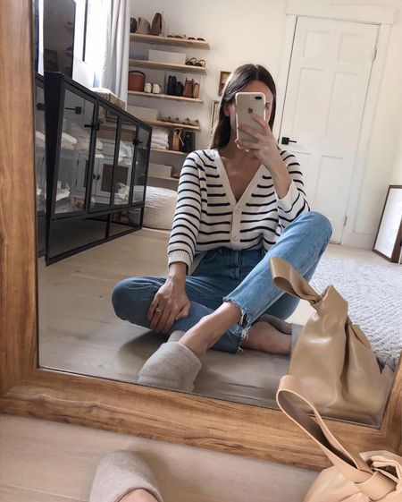 Striped sweaters, raw denim and cashmere slippers. ✔️ My slippers are restoration hardware and I shared a few striped sweater dupes. One can be worn crewneck with buttons down the back or as a cardigan! 🤍  #LTKstyletip #LTKhome #LTKSeasonal