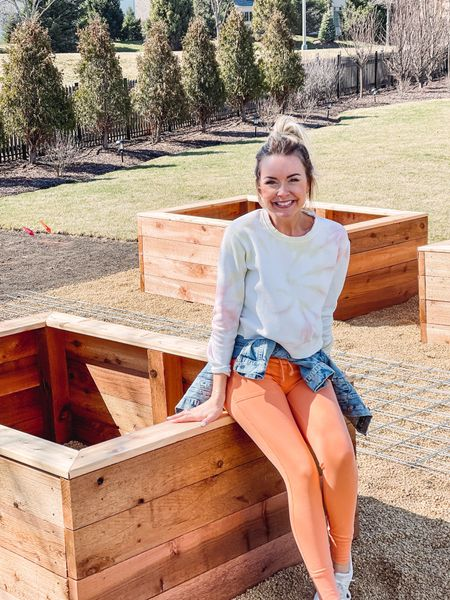 """""""If you build it, he will come"""" - at least that's what I'm hoping for with these beautiful garden boxes!!  Tell me ya know what movie that's from!   This is just the beginning of our new garden!  Next up, the shed is being built and then will be installed.  We then have add more gravel to level everything out and get the garden beds and archway in place.  Followed by filling the beds with compost, then it's TIME TO PLANT!!  I truly can't wait!  Any recommendations on what to plant?? 🌱🌿   [wearing XS in jogger leggings, top, and jacket and shoes are TTS]"""