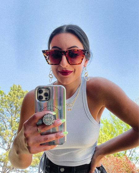 http://liketk.it/3cP1V #liketkit @liketoknow.it   A tank too good for $12!   Amazon sunglasses, ribbed tank top, gorjana jewelry, butterfly necklace, selfie light phone case, holographic phone case,