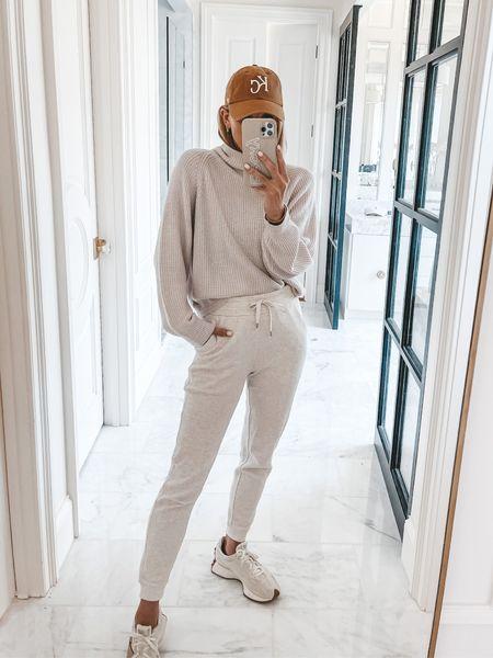Lululemon sweater size small, and joggers wearing size 4
