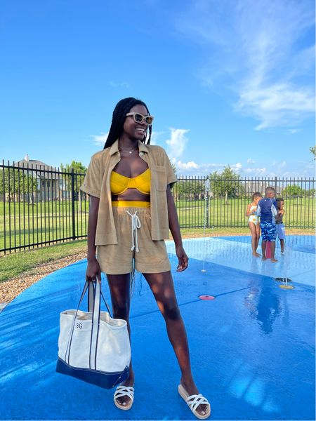 Yellow 90s swimsuit top with high waisted bottoms, tan terry resort shirt and coordinating shorts, custom tote bag and white puffy strap pool slides.   #LTKswim #LTKtravel #LTKunder100