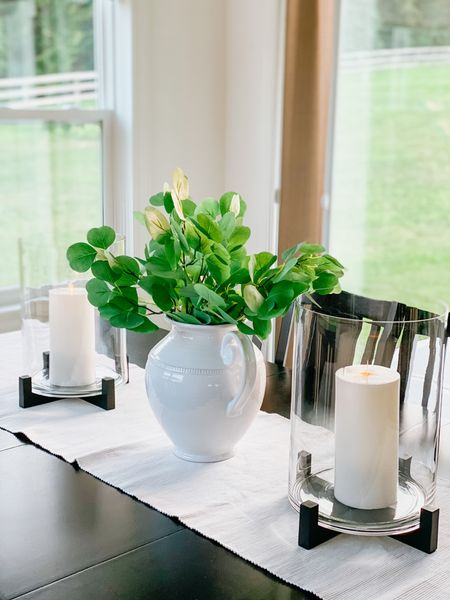 Simple dinning table centerpieces with large candleholders and pitcher filled with flat leaf eucalyptus.   These flameless (battery operated) candles are wax and look incredibly real.   Pottery Barn, frameless candles, Studio McGee, neutral Decor, dinning room decor, glass hurricane, white home     #LTKunder100 #LTKhome