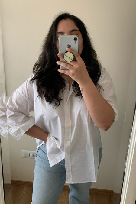 Prepping my Monday outfit – can't go wrong with a classic poplin white shirt and blue jeans! I'm wearing a UK 14 for the shirt for an oversized fit, and straight leg jeans 👖   #LTKeurope #LTKSeasonal #LTKDay