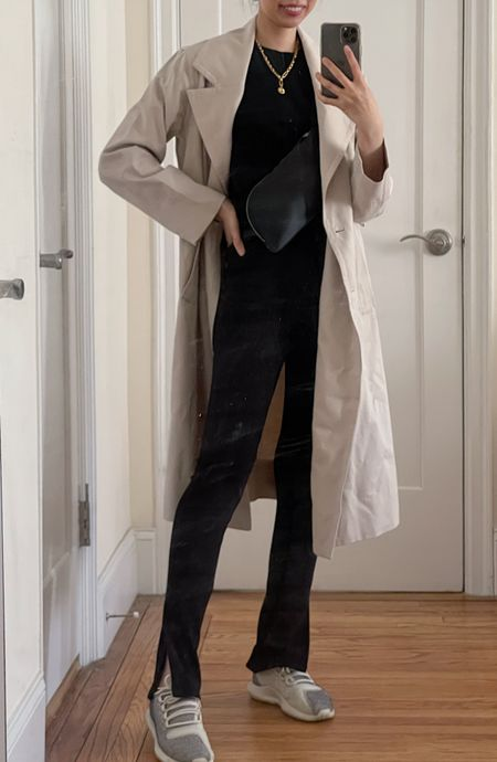Spring outfit, spring look, trench coat, spring jackets, all black outfit, spring trench, crossbody bag, fanny pack, sling bag, cashmere sweater, cashmere tee, slit leggings, business casual, work outfit, work look, classic style, everlane,   #LTKworkwear #LTKSeasonal #LTKunder100