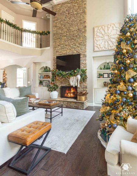 Green, blue and gold is on of my favorite Christmas color combinations! Home decor Christmas decor living room mantel decor pottery barn sofa coffee table green pillows teddy bear throw  #LTKhome #LTKSeasonal #LTKHoliday