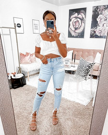 """I am 5'4"""" rocking these jeans in a size 00 and small in the crop top.    http://liketk.it/3gKlf @liketoknow.it #liketkit Steve Madden, mom Jeans, high waisted stretch jeans, studded sandals, flat sandals, crop top, ruffle sleeve top, the styled collection, jewelry, AE, American Eagle, accessories, distressed jeans, distressed denim  #LTKunder100 #LTKstyletip #LTKtravel"""