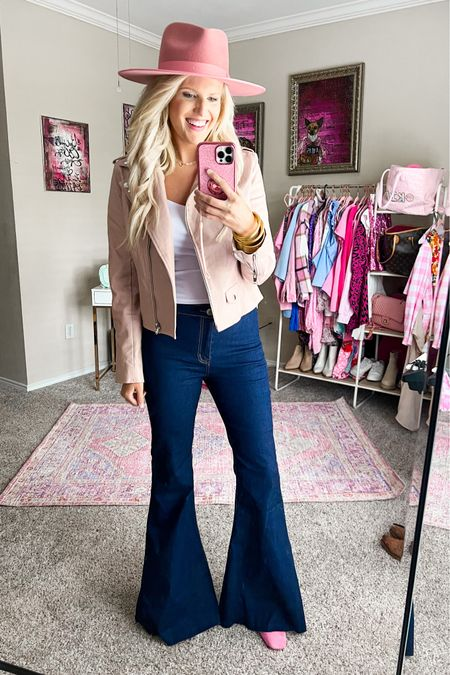 Buddy love blue flare jeans - Run large so size down. Other flare jeans linked   White crop tank size M.  Blush pink studded leather jacket size M-comes in other colors.  Pink booties TTS Pink fedora  Western outfit, concert outfit, fall outfit Gold bracelet stack  Target gold hoops    #LTKunder100 #LTKstyletip #LTKSeasonal