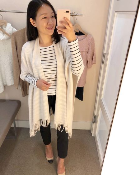"""This fringe wrap is perfect for chilly offices and currently 40% off (use code NEWNOW). For reference I am 5' 2.5"""". I was disappointed that the new kitty striped tee is VERY long and tunic length on me (it hit mid thigh on me) so I tucked it here. Shop a few of my favorite sales picks @liketoknow.it  http://liketk.it/2xp1t #liketkit #LTKsalealert #LTKstyletip  #LTKshoecrush  #LTKunder100   #LTKunder50"""