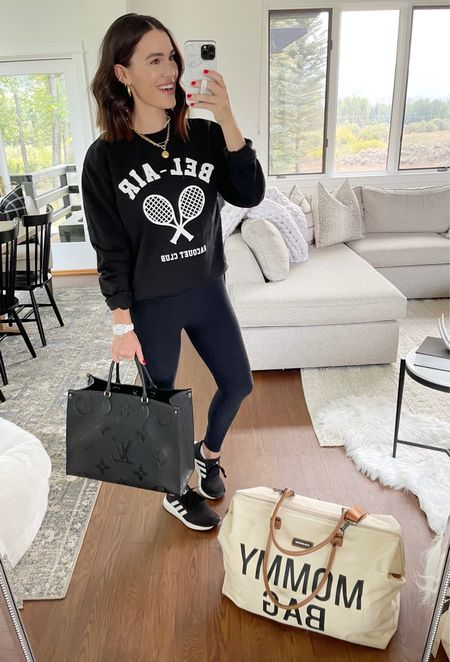 F A S H I O N \ Today's road trip look🖤 My go-to leggings and sneakers paired with a new cayuuuute sweatshirt and totes!   #leggings #activewear #tote #loungewear #mom #mama #sweatshirt #momoutfit #travel #traveloutfit  #LTKstyletip #LTKunder100 #LTKtravel