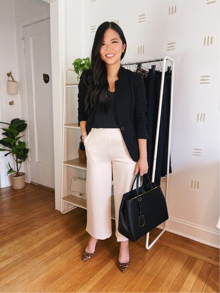 These wide leg pants are perfect for a business casual outfit. They have an elastic waistband, making them equal parts polished and comfy. Only $41 and comes in a few different colors. S was a little tight in the crotch, but M fits perfectly!   Paired these work pants with a black tank top (XS) and black blazer (similar options linked). Rose gold Apple Watch band, similar leopard pumps and similar black tote bag linked.  Amazon fashion, Amazon finds, business casual, work outfit, teacher outfit, work from home style, work pants, fall style, teacher style, work blazer.  #LTKworkwear #LTKunder50 #LTKstyletip