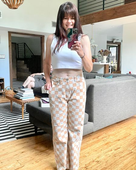 Easy summer dressing includes crop tops and fun printed bottoms. #partypants . . I wore these checkerboard pants to go axe throwing and I lost count of the number of modern day Viking looking gentlemen who went out of their way to tell me how much they loved them.  . Could there be a better compliment than that?  . . Linked to a few fun options below. And speaking of fun….. have you tried axe throwing yet? I went with besties and we brought wine and a cheese platter. Highly recommend!  . Plus, if it's good enough for modern Vikings a f Jason Momoa, it is good enough for me! . .  You can instantly shop my looks by following me on the LIKEtoKNOW.it shopping app http://liketk.it/3iG73 #liketkit @liketoknow.it #LTKstyletip #LTKsummerstyle