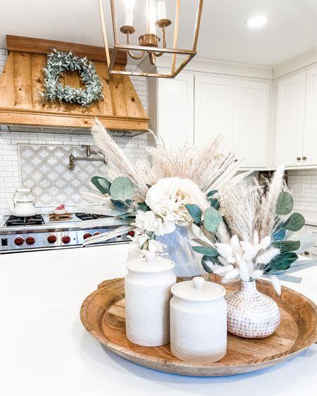 Kitchen island decor   Kitchen cabinet hardware- antique brass Anthropologie vase Afloral stems Pot filler Wood tray   http://liketk.it/35UCZ @liketoknow.it #liketkit @liketoknow.it.home #StayHomeWithLTK #LTKhome #LTKunder50