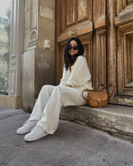 All white look in Paris with camel Dior Bobby Bag