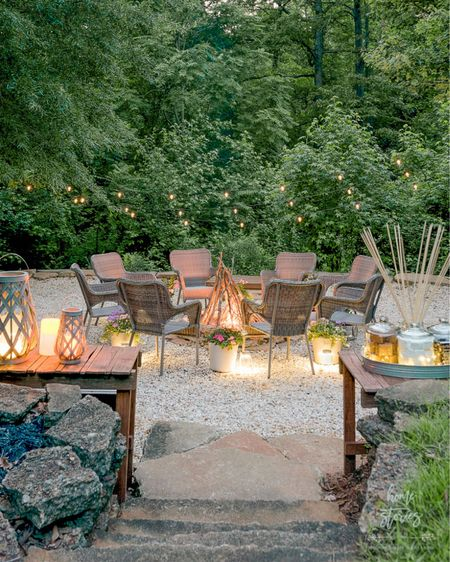 One of the best things we did last summer was add this pea gravel fire pit with solar powered string lights. I have three strands of lights hanging from the trees and they are still going strong after a year! This is one of my favorite spaces to entertain and even sit during the day. It's shady, private and cool, and the wild blackberries growing all around are almost ripe for picking! Shop this space on @liketoknow.it ! http://liketk.it/3ieCv #liketkit #LTKhome