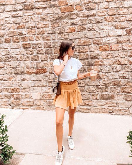 Summer outfit / mini skirt / white top / golden goose http://liketk.it/3jYee #liketkit @liketoknow.it