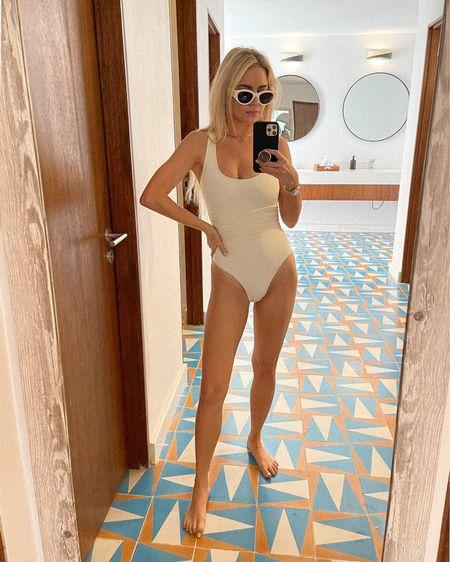 White sunglasses, white bathing suit, beach outfit, vacation outfit, vacation style http://liketk.it/3etjb #liketkit @liketoknow.it #LTKswim #LTKtravel #LTKstyletip