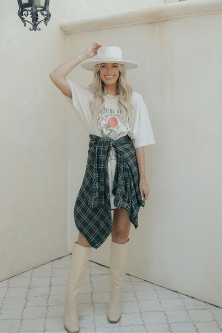 An oversized graphic tee, flannel, & boots make for a comfy yet trendy fall look 🤍 everything is linked in the @shop.LTK app! -@champagneandchanel