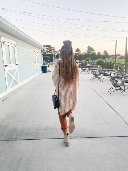 Such a cute fall wedding outfit!! Love these rust joggers you can dress up or down with these fall staple booties   #LTKSeasonal #LTKshoecrush #LTKGiftGuide
