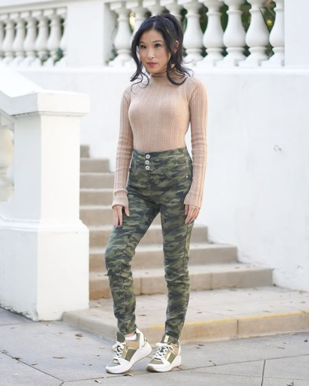 Army and camp pants paired with a neutral camel color top and olive green sneakers to match! I love wearing my Michael Kors wedge sneakers paired with these high/waisted cami pants. The button up detail on the camo pants add extra style to a comfy, affordable look! http://liketk.it/375iE #liketkit @liketoknow.it #armygreen #camo #camopants #highwaistedjeans #asos #michaelkors #LTKunder100