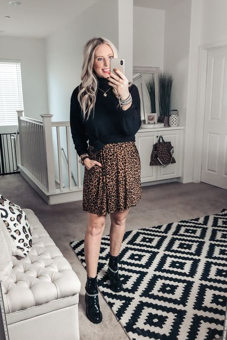 Knotted up this black tunic over a $13 leopard swing dress ❤️ perfect with combat boots for a fall outfit! Small dress Med tunic    #liketkit @liketoknow.it http://liketk.it/2YrvZ #LTKunder50 #LTKstyletip #LTKsalealert