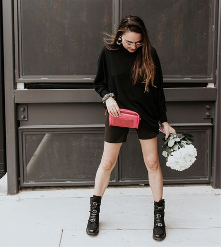 Black biker shorts. Spring outfit. Summer outfit. Nashville outfit. Spring fashion idea. Biker shorts outfit. Monochrome black outfit. Chunky boots, oversized black sweater.   #LTKSeasonal #LTKstyletip #LTKunder100