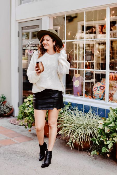 Sipping in style with my brumate gold leopard wine cup and my ChicWish oversized sweater and leather like skort.    #LTKunder50 #LTKSeasonal #LTKshoecrush