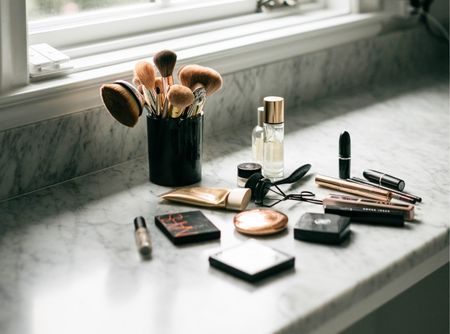 STEP BY STEP HOLIDAY MAKEUP ROUTINE from Nordstrom Beauty:   To prep the skin I start with the Saint Laurent blur primer in Gold. This quick little step really helps smooth your skin and keeps your makeup in place. My mom got my sisters and I hooked on this primer years ago! I apply Jane Iredale Glow Time Full Coverage Mineral Bb Cream in the shade BB3 with my Artis brush in no. 10. I love this Bb Cream because it feels really lightweight but still has good coverage and a pretty glow. I like this better than foundation because it does not feel or look heavy. To set everything I use Charlotte Tilbury flawless setting powder in the shade light. For a pretty sun kissed look I apply Nars bronzer in the shade Laguna. I use this big fluffly bronzer brush to apply it in a 3 on each side of my face and blend. To brighten the under eye area I use Bobbi Brown skin serum concealer in the color Porcelain. I recommend going a shade or two lighter than you would concealer to really brighten the area. To blend it in, I use my Artis brush. This under eye serum concealer has been my favorite since high school because it is really lightweight and easy to blend in. For a pop of pink blush I use Chanel in the shade Rose Initial with this brush. For eye shadow I always stick to neutrals. I apply the lightest eye color under my brow to brighten, the medium golden color to the entire lid and the darker brown in a V shape on the outer lid for a bit contour. This pretty eye palette from MAC is perfect for a compact travel set. For a little extra sparkle dot this cream shadow in Champagne on your lids! I set my brows with clear brow gel to keep them in place. Next I use MAC liner in the color Brownborder. I curl my lashes before applying Lancome Lash Idole mascara. I LOVE this mascara because it does not clump like many others. Finally I use Lancome le crayon lip liner in the color Caramel and Mac lipstick in Blankety for a very natural look on my lips. Blend everything together and ready fo