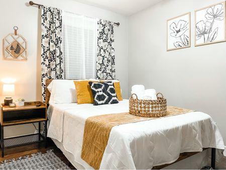 Black and white elegant Boho bed room with pops of mustard and cane.  #LTKunder50 #LTKstyletip #LTKhome