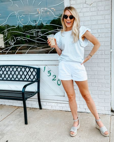This cute blue and white ruffle top is only $20 but totally looks designer! http://liketk.it/3edss #liketkit @liketoknow.it #LTKunder50