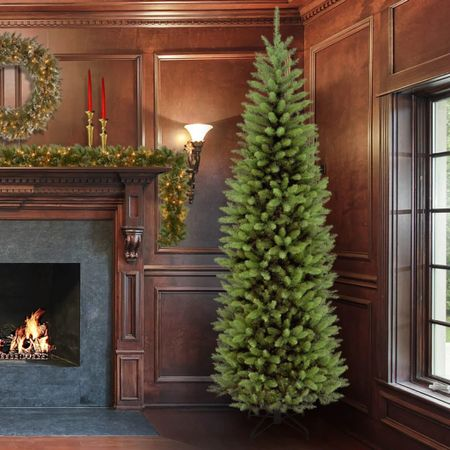 The time is now to buy that new Christmas tree! This slim tree has amazing reviews and price point is unmatched. I have a tree almost identical and I love it. TIP:  but the 4 ft for your bathroom. Trust me 🌲 #christmasdecor #christmastree #holidaydecor #wayfair   #LTKSeasonal #LTKhome #LTKHoliday