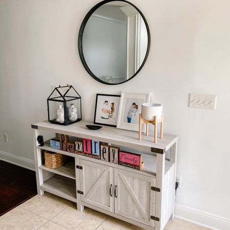 Our entry way table (technically sold as a tv stand) is on sale right now! We used it as a TV stand for a long time before we moved and now it's a cute entry way table! Also linking this flower pot, that I still need to put a plant in, similar mirror and lanterns! Everything here found on Wayfair, Target or Amazon! http://liketk.it/3dtaJ @liketoknow.it #liketkit #LTKhome #LTKsalealert #LTKfamily