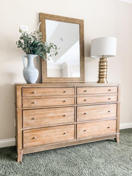 Love this 8 drawer dress in the primary bedroom   Bedroom furniture, dresser, bedroom decor, gold lamp, wood mirror  #LTKhome