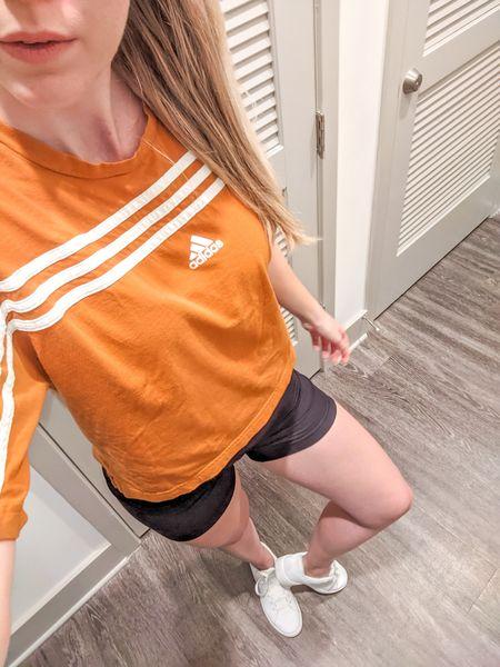 Everyday sporty Adidas and Nike look. Cropped tee in rust orange, black biker shorts, and all white Nike Court Royale 2 sneakers. http://liketk.it/3lXZb @liketoknow.it #liketkit #LTKstyletip #LTKunder50 #LTKshoecrush #LTKfit