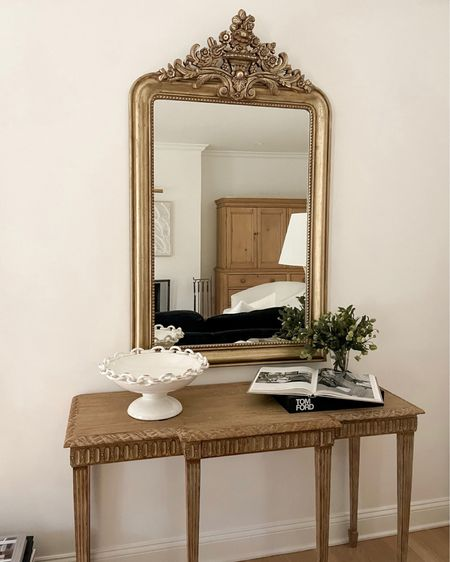 Styled table with mirror and coffee table book. #homedecor #tomford  #LTKstyletip #LTKhome