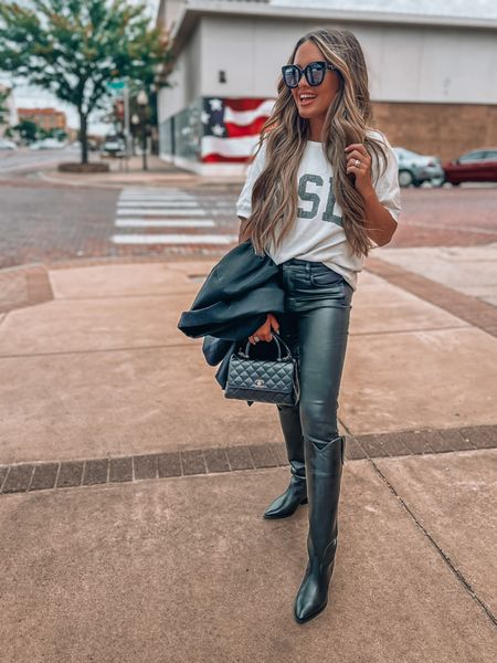 Black leather pants, black boots, black blazer and graphic tee 🖤