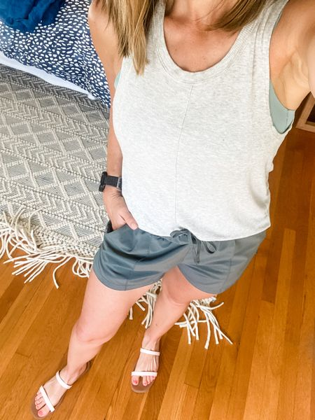 This gray workout top has become one of my all time favorites because of the cute seam down the middle! I'm also loving these white sneakers— cute enough for a casual outfit but also made for fitness so great for walking with Thomas 🙌🏼 #athleisure #casualeveryday #LTKSeasonal   #LTKunder100 #LTKSeasonal
