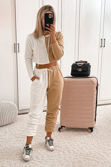 Comfy lounge travel outfit  Tan white jogger set size small Golden goose sneakers  Luggage set  #travel #outfit #laurabeverlin   #LTKtravel #LTKunder50 #LTKshoecrush