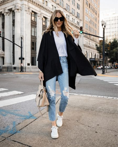 Love this black poncho for fall! So easy to layer over a causal outfit and great for travel outfits too! #poncho #falloutfit   #LTKunder50 #LTKstyletip #LTKunder100
