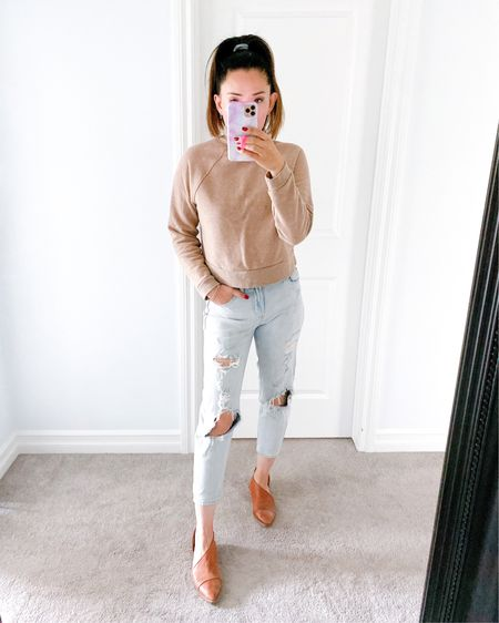 Lovin this mock neck sweat shirt, paired with distressed mom jeans, free people royale, and the best basic tank top. Wearing size small tops, size 2 in jeans (size down 1!) http://liketk.it/2WFzv #liketkit @liketoknow.it #StayHomeWithLTK #LTKshoecrush #LTKstyletip