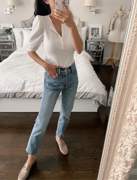 40% off my elevated white tee - Henley top with sleeves in a different fabric with a subtle puff shoulder. Pairs easily with jeans (these are Levi wedgie 24 with hems cut) or work outfits. Also comes in a beautiful blue and deeper navy. Wearing xxs P but Petite ladies should be able to take regular sizing too since this is a mid length sleeve!   #LTKunder50 #LTKSale #LTKstyletip