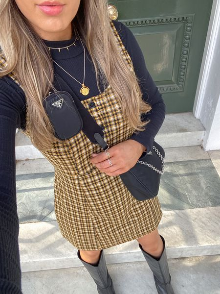 A very autumnal outfit. I love layering roll neck jumpers underneath cute check dresses like these.   #LTKeurope #LTKstyletip #LTKunder50