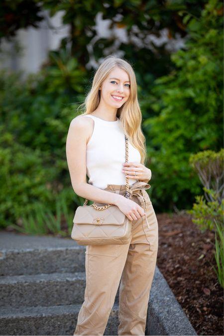 White halter knit tank from chicwish Beige tan cargo style pants with tie belt Chanel 19 dark beige  Dior slide sandals    #LTKunder100 #LTKunder50 #LTKstyletip