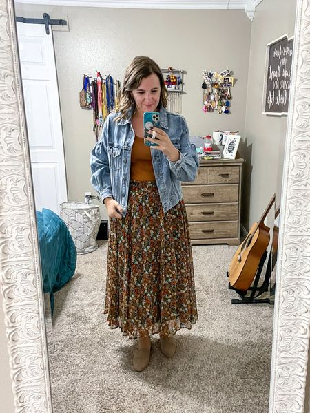 This floral midi skirt is so versatile! Throw in a jean jacket and tank and you're set for a cute teacher outfit.   #LTKstyletip #LTKcurves #LTKunder50