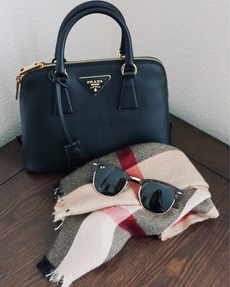I personally love items that are versatile ☑️, elevated ☑️, and timeless ☑️. These 3 accessories have been in my wardrobe for many years and worn on countless occasions: the Prada Promenade bag with its elegant, structured silhouette, the classic Ray-Ban Clubmaster, and the plaid Burberry scarf ❤️ Similar styles linked in the @liketoknow.it app! http://liketk.it/3e762 #liketkit #LTKstyletip  #ChicStyle #Accessories