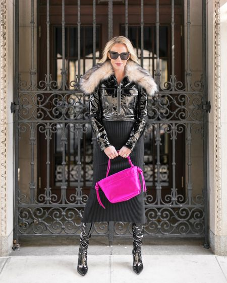 I always think the way to spice up a Winter all black or neutral outfit is with a standout accessory. I love a sparkly statement earring, an interesting scarf, a pair of detailed boots, or in this case, a bold bag.   This bright pink bag by  is just the right pop of color to give this cold weather ensemble some electricity. 🖤  Photo Cred:   http://liketk.it/2IIAg #liketkit @liketoknow.it