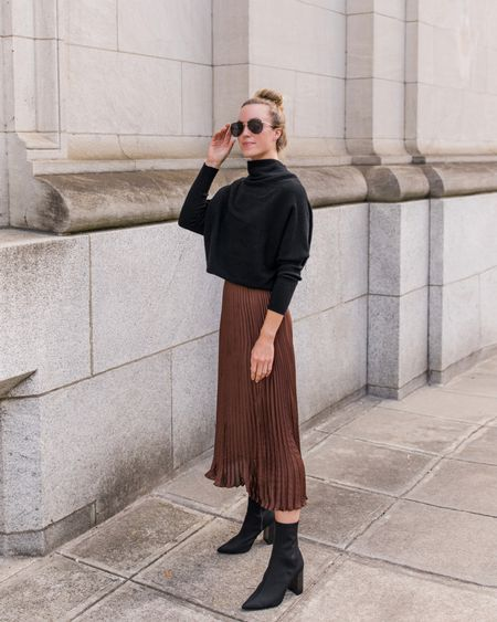 Sweater is TTS and comes in more colors. Exact skirt is Banana Republic and sold out. Booties are old Steve Madden, similar linked. Sunglasses from Amazon are a Dior lookalike for under $20!  Tags: Fall Skirt Outfit, Thanksgiving Outfit, Thanksgiving Outfit Womens, Pleated Skirt, Fall Skirt, Black Ankle Booties