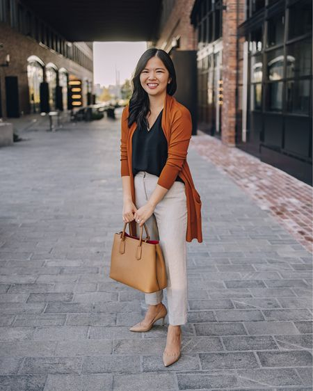 This work outfit is perfect for the business casual office: rust cardigan (XS), black tank (XS), gray work pants (4P), nude pumps (6.5 TTS) and a neutral tote bag.  Work style, business casual style, Amazon finds, Amazon fashion.  #LTKunder100 #LTKworkwear #LTKunder50