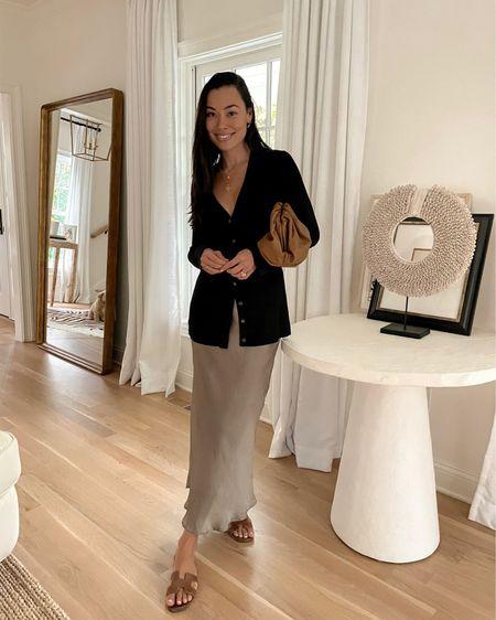 Long cardigan and a silk midi skirt. http://liketk.it/3gvrl #liketkit @liketoknow.it #LTKitbag #LTKstyletip #LTKunder100  #hermessandals #bottegapouch #silkskirt