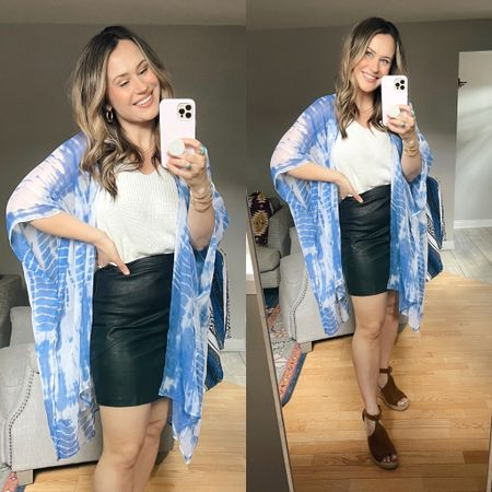 How to style this faux leather skirt: this would be the perfect brunch outfit or casual date outfit! paired it with a white tank, this top is an amazon find, my kimono is a wal mart find and these wedges are an amazon find   #LTKunder50 #LTKstyletip #LTKshoecrush