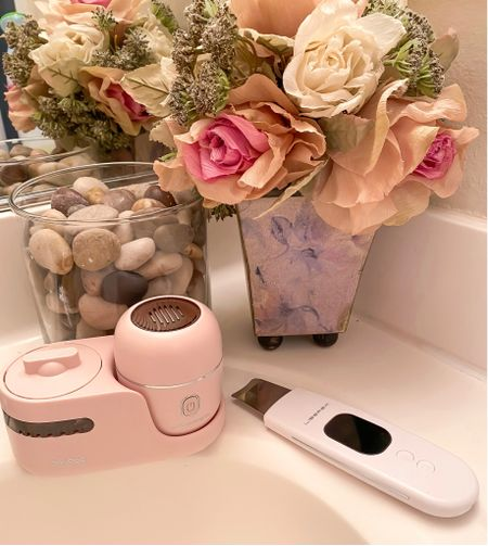 My skin scrubber and cleansing brush with the UV sanitizer station! Love both of these, check out my full blog post on them :)